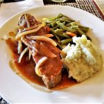 Meatloaf, mashed potatoes and green beans and carrots.
